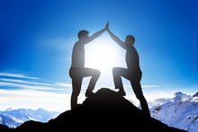 Fotobehang - Male Friends Giving High Five On Mountain Peak