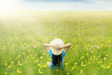 Fotobehang - Happy woman enjoy springtime on meadow