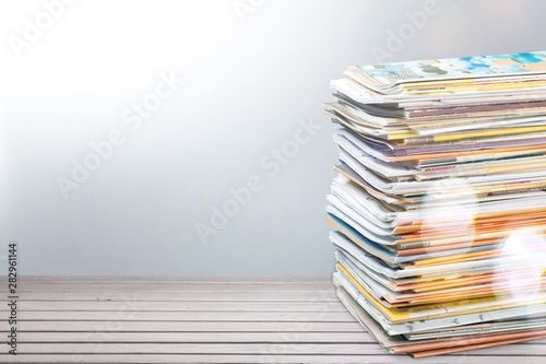 Fotobehang - Pile of newspapers on white background
