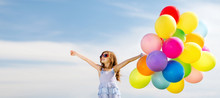 Fotobehang - happy girl with colorful balloons