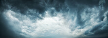 Fotobehang - Dramatic Sky Background. Stormy Clouds in Dark Sky. Moody Cloudscape. Panoramic Image Can Be Used as Web Banner or Wide Site Header. Toned and Filtered Photo with Copy Space.